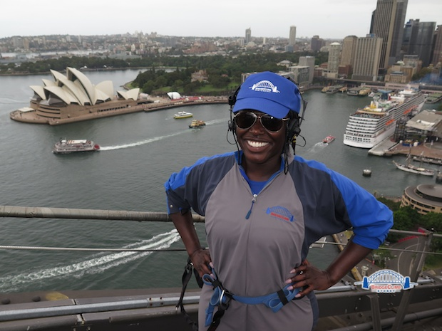 A student stands proud on top of the Harbour Bridge after climbing to the top during TEAN Orientation in Sydney