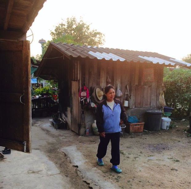 My Thai village host mother and the dreaded outhouse behind her... I survived, so will you.