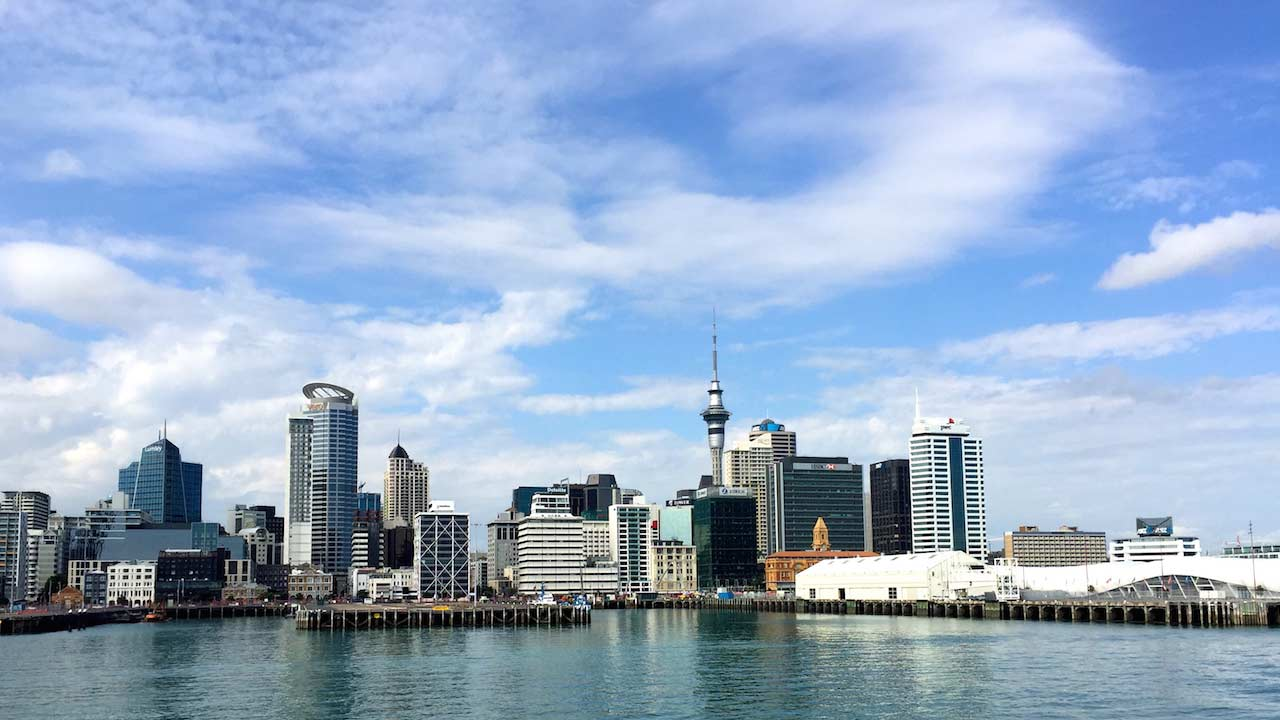 Auckland's cityscape, waterfront view on a sunny day