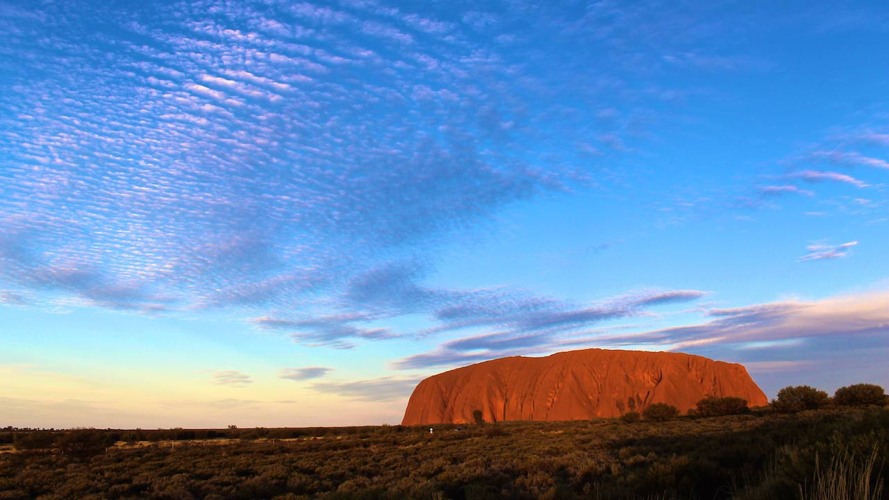 Uluru, in the heart of the Northern Territory of Australia at dusk