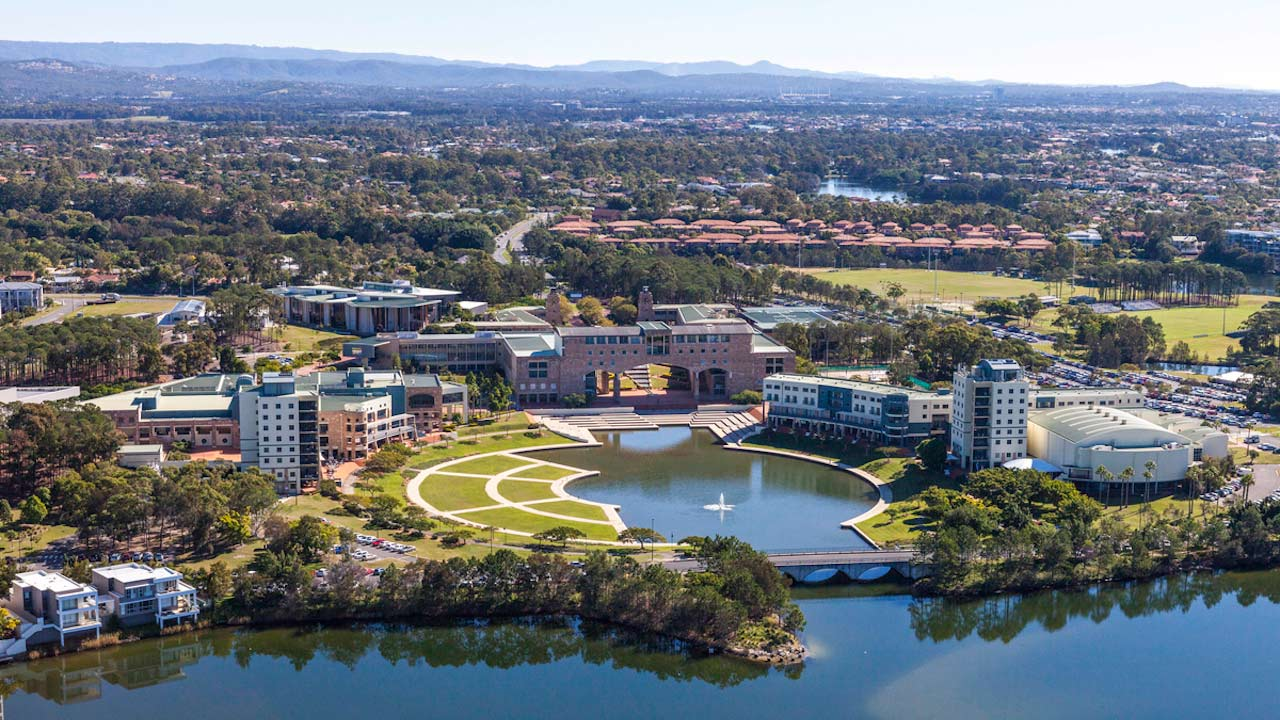 A view of Bond's campus from the lake to the city beyond