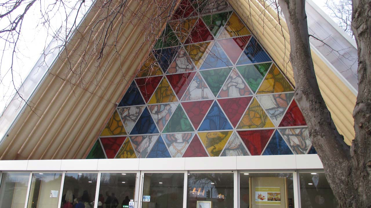 A triangular window filled with smaller colorful triangles