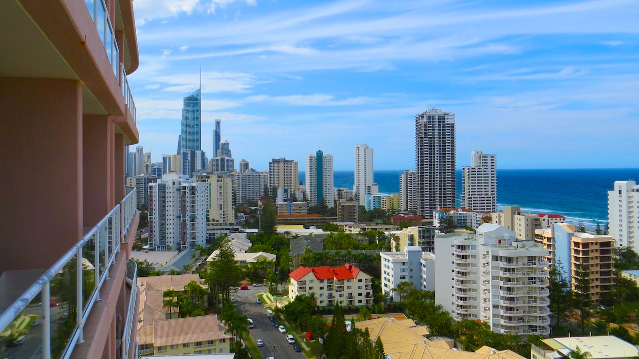 View of the Gold Coast's cityscape and ocean horizon from the balcony of a building