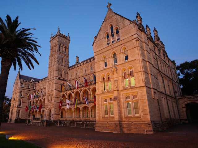 A prominent building on ICMS campus illuminated at dusk