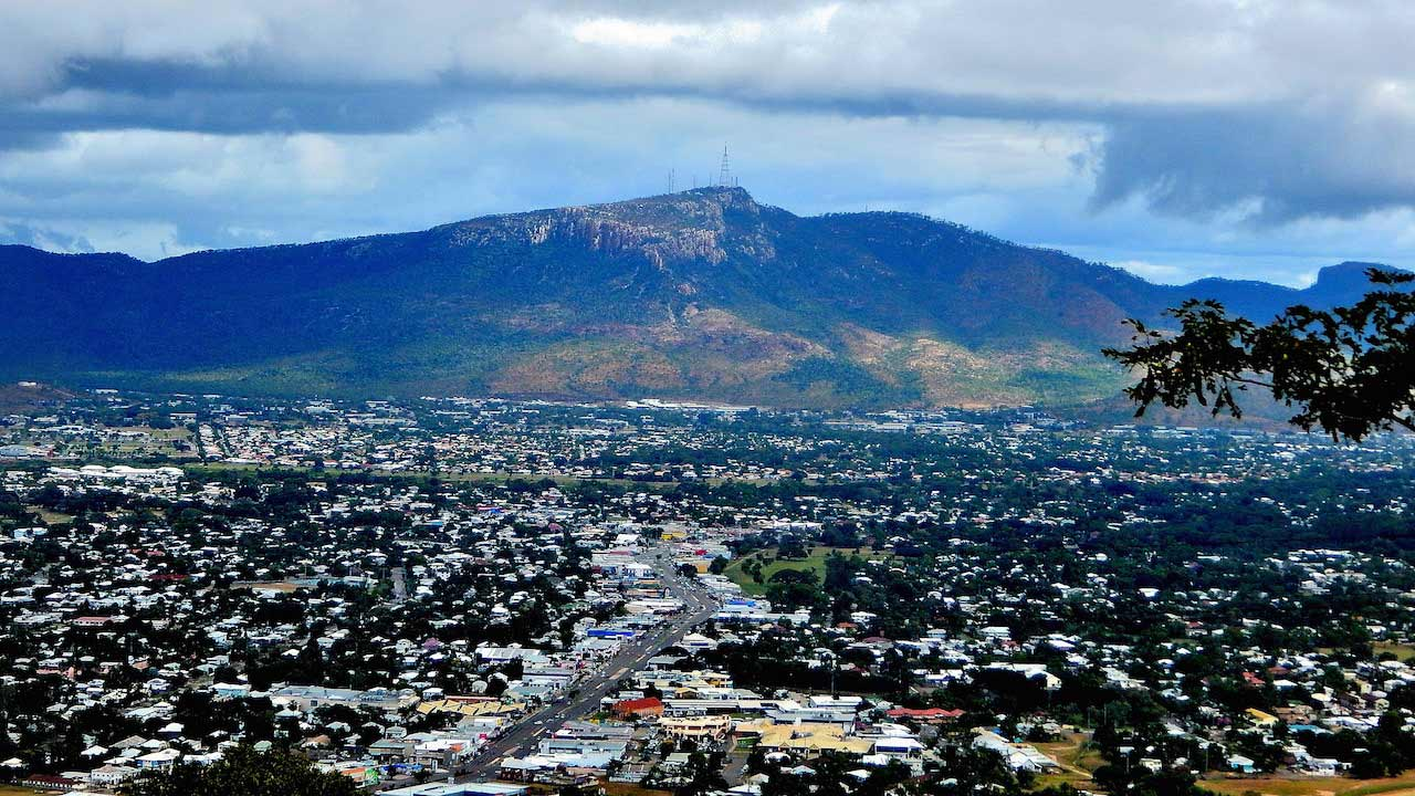 A an aerial view of Townsville's sprawling landscape and mountain range