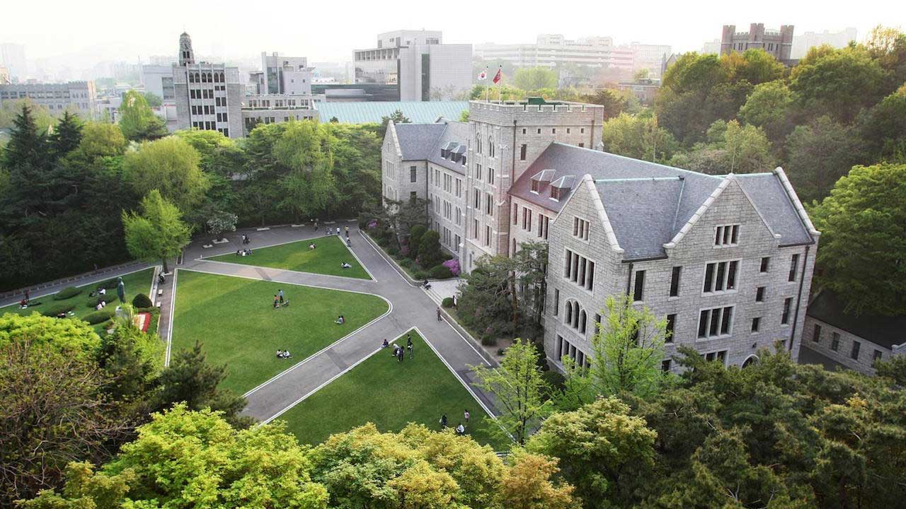 Korea University's main hall from above surrounded by greenery