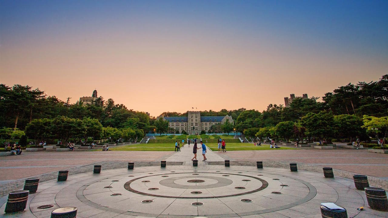 An outdoor, circular area on Korea University's campus at dusk