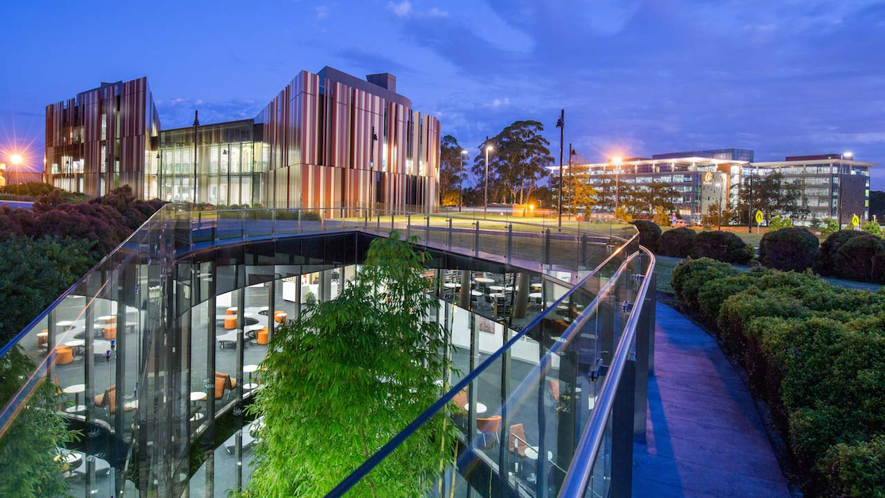 The exterior of the rear of Macquarie University's library at sunset