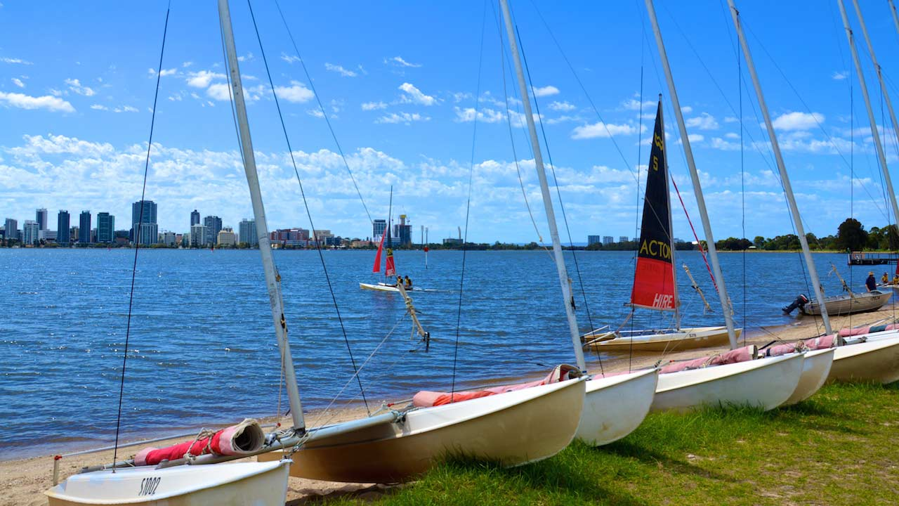 Sailboats docked along the shore in Perth, Australia