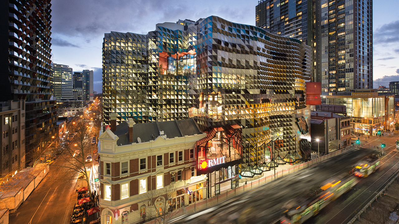 RMIT's urban campus illuminated at dusk