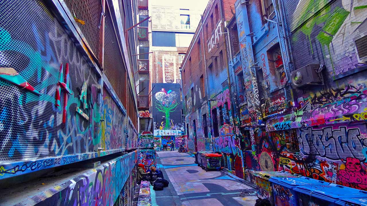 An alleyway in downtown Melbourne that is covered in graffiti from local artists