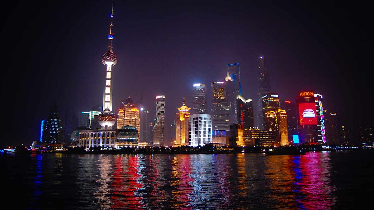 Shanghai's infamous cityscape illuminated colourfully at nighttime