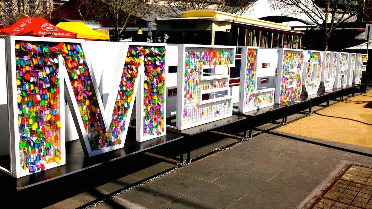 Large colorful block letters spelling Melbourne on the street