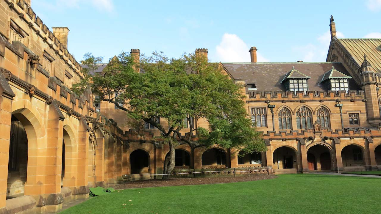 Hogwarts-like architecture on University of Sydney's campus on a sunny day