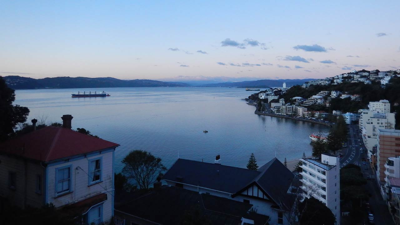 Wellington harbour and surrounding neighborhoods at dusk