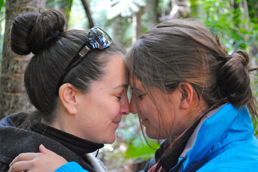 "Photo of greeting one another with the hongi and exchanging the ""ha"" or ""breath of life."" Photo by Alicja Reczynska, University of Maryland who studied abroad in new Zealand."