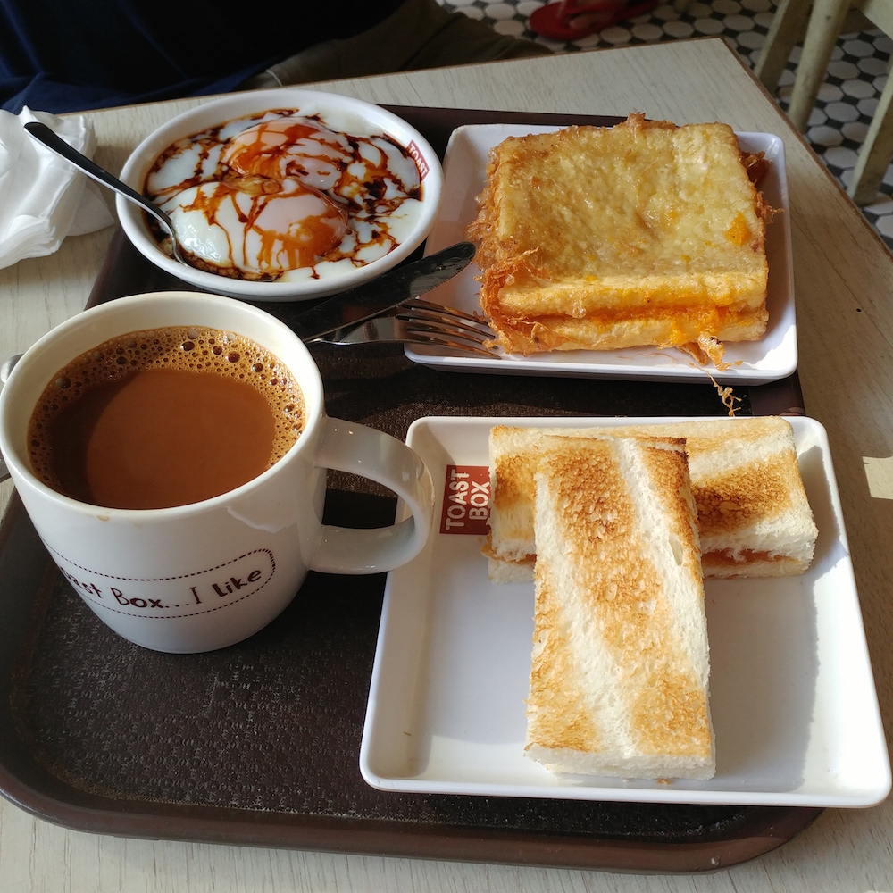 Kaya toast and soft boiled eggs - a popular breakfast or snack in Singapore