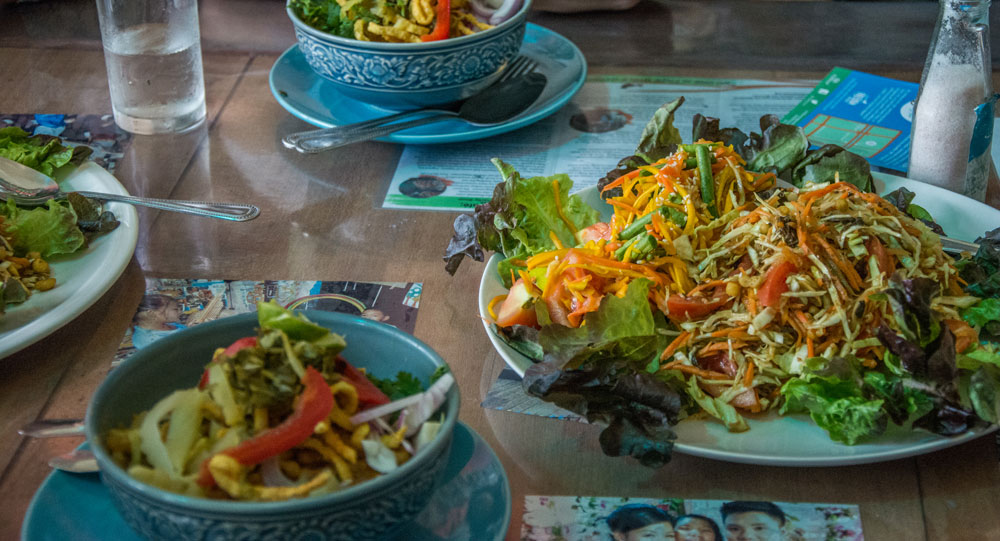Shan salads and khao soy at Free Bird Cafe in Chiang Mai