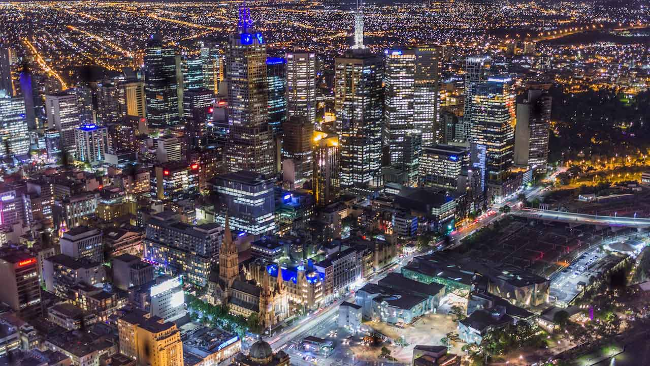 An aerial view of Melbourne illuminated at nighttime