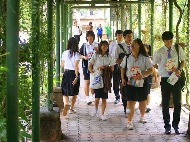Chiang Mai University students walking through on-campus