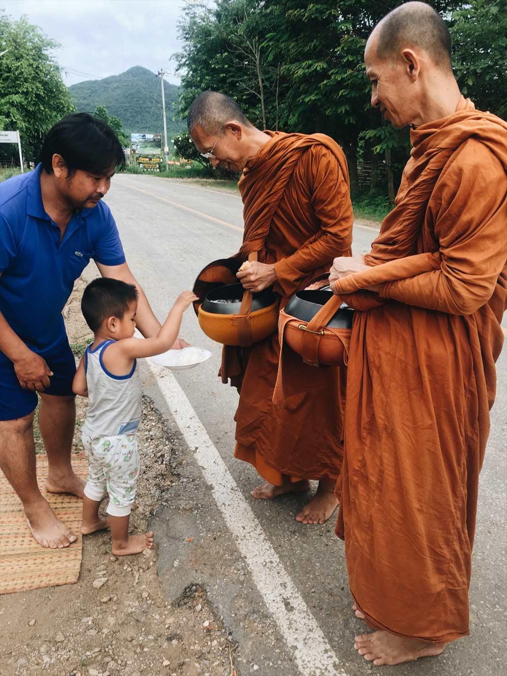 Buddhist monks alms round Thailand